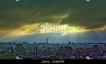 Glasgow, Scotland, UK 15th October, 2019. UK Weather: Cloudy weather with the promise of rain saw storm clouds that provided a spectacular display of sunbeams or god rays as Crepuscular rays are commonly known as over the west end  of the city. Gerard Ferry/ Alamy Live News - Stock Photo