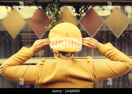 A fashionably dressed woman in the trendy colors of the fall - Stock Photo