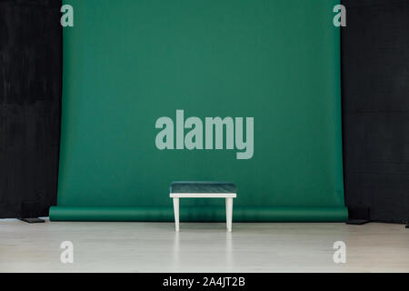black green background in the interior of the room and chair - Stock Photo