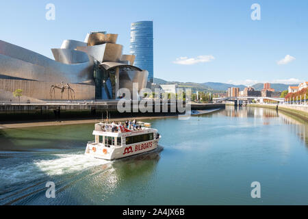 Bilbao river cruise boat on the Nervion river passing the Guggenheim Museum, Bilbao, Basque Country, Spain, Europe