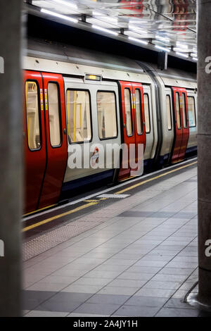 A metro train in the Tube of London - Stock Photo