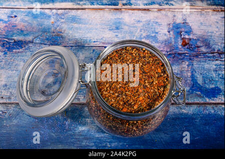 Fragrant spices in a glass jar with a lid and a metal lock. Close up - Stock Photo