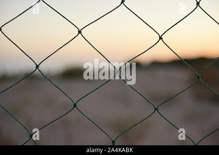 Wire mesh in a beach - Stock Photo