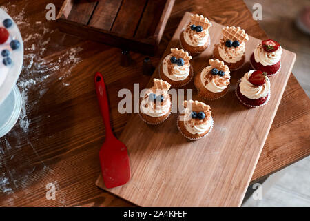 home made cupcakes for children, pleasure, top view photo - Stock Photo