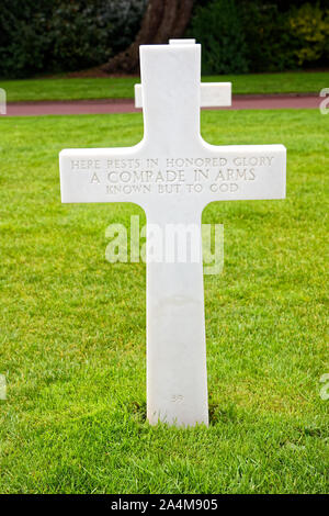 white cross, unknown soldier, Normandy American Cemetery; engraved words, close-up, somber, grave marker, military dead; 1944 D-Day operations; WWII, - Stock Photo