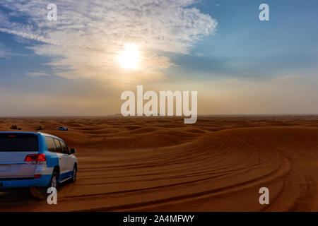 Desert safari sand bashing adventure in Dubai at sunset - Stock Photo