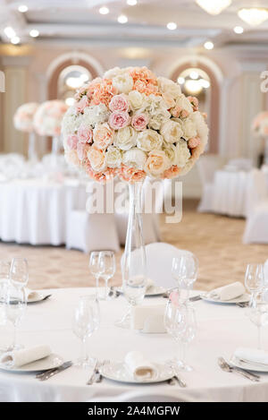 The holiday table is decorated with a large bouquet of fresh flowers - Stock Photo