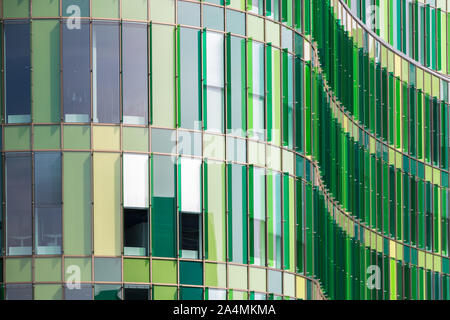 Perspective of the facade of a modern office building with cool green glass panels. Modern architecture - Stock Photo
