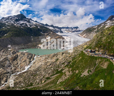 Aerial view of the melting Rhone glacier and the glacial lake in the Swiss Alps - Stock Photo