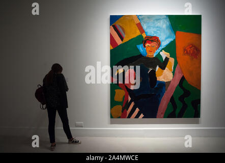 Malaga, Spain. 15th Oct, 2019. A visitor looks at a painting during the exhibition.'Eleuthera' is an exhibition at Contemporary Art Center with more than 40 works from Sean Scully as paintings, photographs and large format drawings. The artist uses colorful shapes and geometrical whose concepts are imaginational, abstract and fatherhood. The exhibit will run from 15 October until 19 January 2020. Credit: SOPA Images Limited/Alamy Live News - Stock Photo