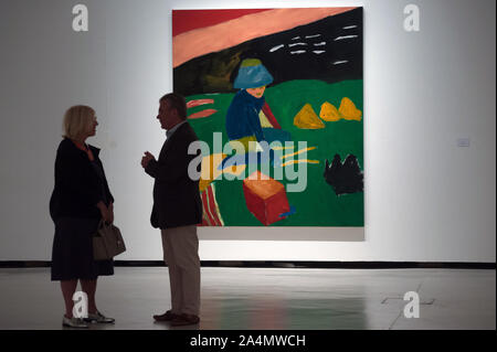 Malaga, Spain. 15th Oct, 2019. Visitors chatting next to a painting during the exhibition.'Eleuthera' is an exhibition at Contemporary Art Center with more than 40 works from Sean Scully as paintings, photographs and large format drawings. The artist uses colorful shapes and geometrical whose concepts are imaginational, abstract and fatherhood. The exhibit will run from 15 October until 19 January 2020. Credit: SOPA Images Limited/Alamy Live News - Stock Photo