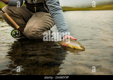 Fisherman with caught fish - Stock Photo