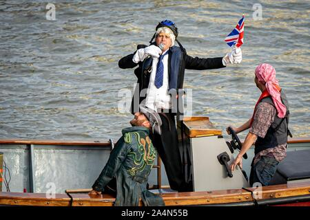 London, UK. 15th Oct, 2019. Extinction Rebellion protesters on a boat near Westminster Bridge with a Boris Johnson impersonator in London, UK. Credit: Vladimir Morozov/akxmedia. Credit: Vladimir Morozov/Alamy Live News - Stock Photo