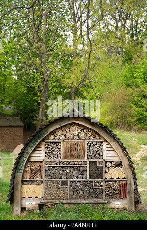 An insect hotel (also called an insect house, bug house, or bug hotel) in a public park in Paris, providing shelter for insects for a better ecosystem - Stock Photo