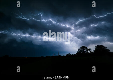 Multiple forked and branched lightning bolts in the sky over northeast Nebraska - Stock Photo