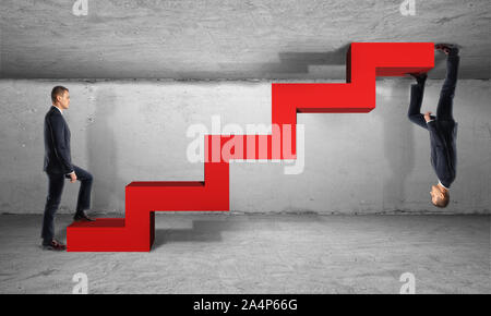Two businessman climb one red ladder from different sides - Stock Photo