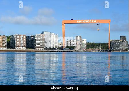 View from Klippan harbor across Gota river towards the old gantry crane at abandoned Eriksberg shipyard in Gothenburg, Sweden. - Stock Photo