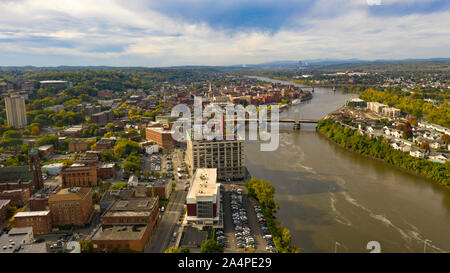 Tugboat and Downtown Troy NY in Rensselaer County along the banks of the Hudson River - Stock Photo