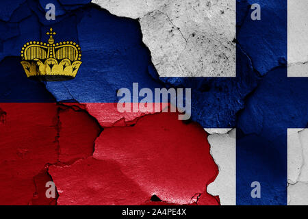 flags of Liechtenstein and Finland painted on cracked wall - Stock Photo