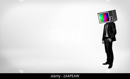 A businessman in a high contrast stands with one arm in a pocket and a TV with color bars instead of his head. - Stock Photo