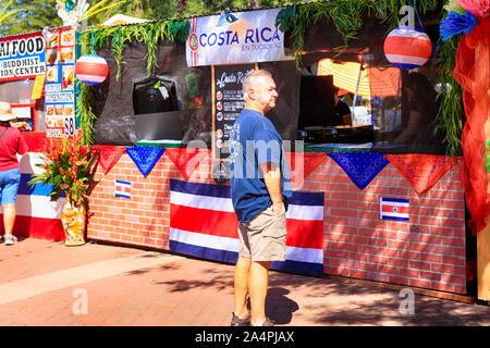 Man standing at a Costa Rica food stand at the Tucson Meet Yourself Folk Festival - Stock Photo