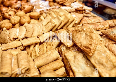 a showcase with bread pastries, a lot of different products from flour, sausage in pastry, pasties, bagels, cheesecakes. - Stock Photo