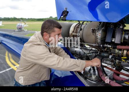 aviation mechanic working on an aircraft - Stock Photo
