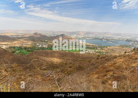 View of Udaipur city and Fateh Sagar lake from Monsoon Palace. Rajasthan. India - Stock Photo