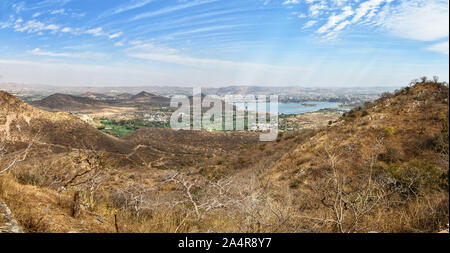 Panorama view of Udaipur city and Fateh Sagar lake from Monsoon Palace. Rajasthan. India - Stock Photo