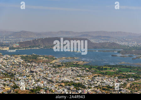 View of Udaipur city and Pichola Lake from Monsoon Palace. Rajasthan. India - Stock Photo