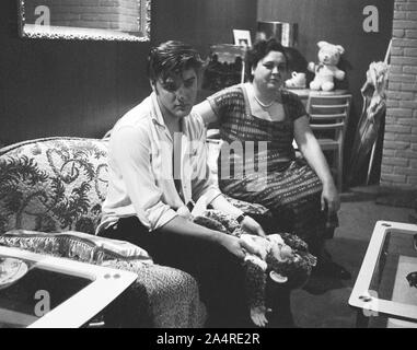 Elvis Presley with his mother Gladys Presley, in the living room at 1034 Audubon Drive, Memphis, Tennessee, May 29, 1956