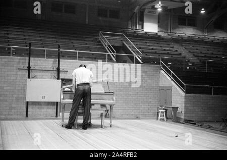 Elvis Presley preparing for a performance at the University of Dayton Fieldhouse, May 27, 1956. - Stock Photo