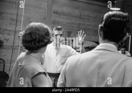 Elvis Presley backstage with fans at the University of Dayton Fieldhouse, May 27, 1956. - Stock Photo