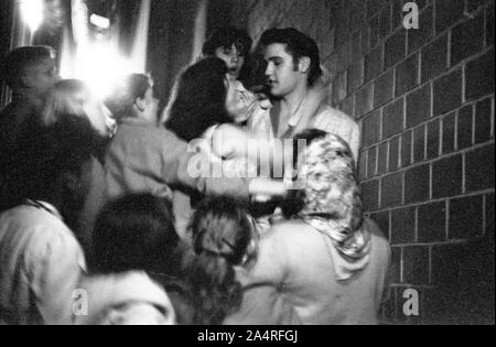 Elvis Presley being swarmed by fans at the University of Dayton Fieldhouse, May 27, 1956. - Stock Photo