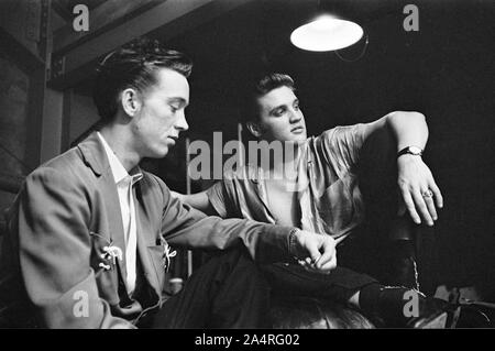 "Elvis Presley and his cousin Gene Smith, backstage at the University of Dayton Fieldhouse, May 27, 1956. Gene Smith was part of Presley's entourage, and is considered a member of the ""Memphis Mafia"". - Stock Photo"