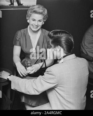 Elvis Presley speaking with a fan at an adult party after his show at the Fox Theater, Detroit, Michigan, May 25, 1956. - Stock Photo