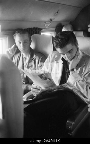 Elvis Presley and his cousin Gene Smith on a bus travelling on tour. The exact date is unknown, but it is probably May 27, 1956 - Stock Photo
