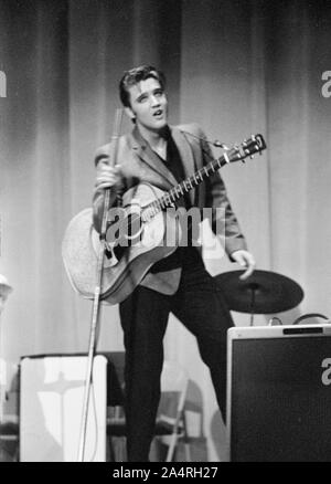 Elvis Presley performing on May 26, 1956. The performance took place at the Veteran's Memorial Auditorium, Columbus, Ohio. - Stock Photo