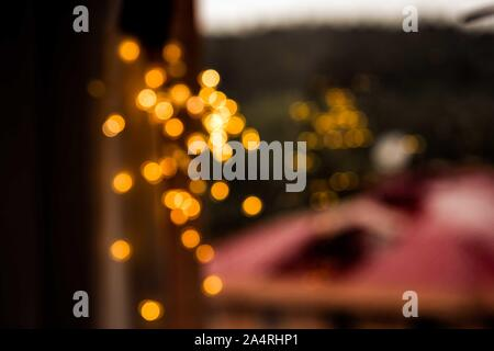 Drops Of Rain On the Glass with autumn city background. Warm Bokeh defocused Lights inside the house.. Abstract Backdrop. Raindrops on a window pane. - Stock Photo