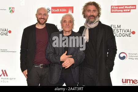 Cologne, Germany. 15th Oct, 2019. Program director Johannes Hensen, l-r, the US American director Abel Ferrara and film producer Michael Weber come to screen the film ' Tommaso ' at the Film Festival Cologne, international film and television festival. Credit: Horst Galuschka/dpa/Alamy Live News - Stock Photo