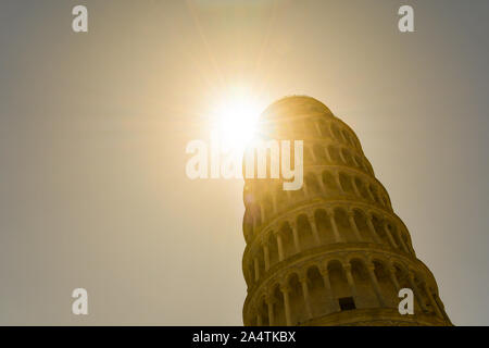 Backlit view of the Leaning Tower of Pisa, the freestanding bell tower of the Cathedral of Santa Maria Assunta in Piazza dei Miracoli, Tuscany, Italy - Stock Photo