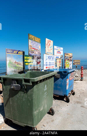 Gouves, Crete, Greece, October 2019.  Rubbish and recycling bins on the beach road in the seaside resort of Gouves, Crete. - Stock Photo