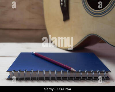 Pencil and book on wooden table, - Stock Photo