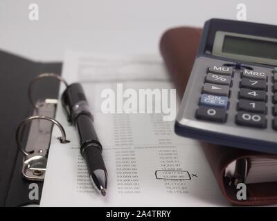 Invoice  and Pen calculator , On Desk. - Stock Photo