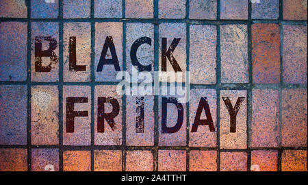 Lettering 'Black Friday' on the colorful wall - Stock Photo