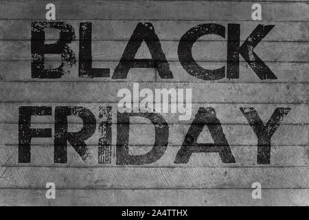 'Black Friday' text on a gray concrete wall - Stock Photo