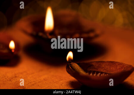 Traditional Diwali Oil lamps or diya lit on the occasion of diwali festival in India with copy space. Background image with bokeh for hindu culture, t - Stock Photo