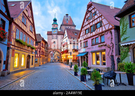 Cobbled street of historic town of Rothenburg ob der Tauber dawn view, Romantic road of Bavaria region of Germany - Stock Photo