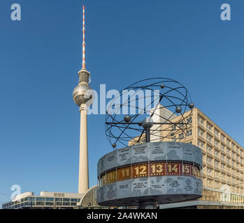 The clock on Alexanderplatz marks 9 am against a beautiful blue sky, Berlin, Germany - Stock Photo