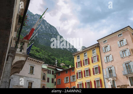 Mountains overlook the Piazza III Novembre, Riva del Garda, Trentino, Italy - Stock Photo